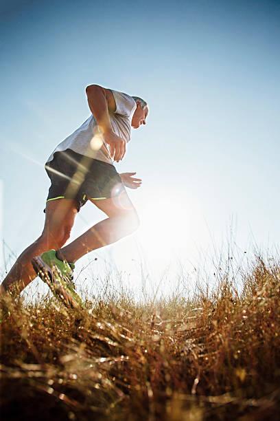 male runner - jogging hill bildbanksfoton och bilder