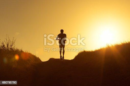 Man running during sunset.