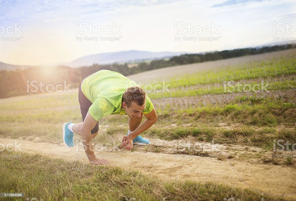 Male runner tripping over stock photo