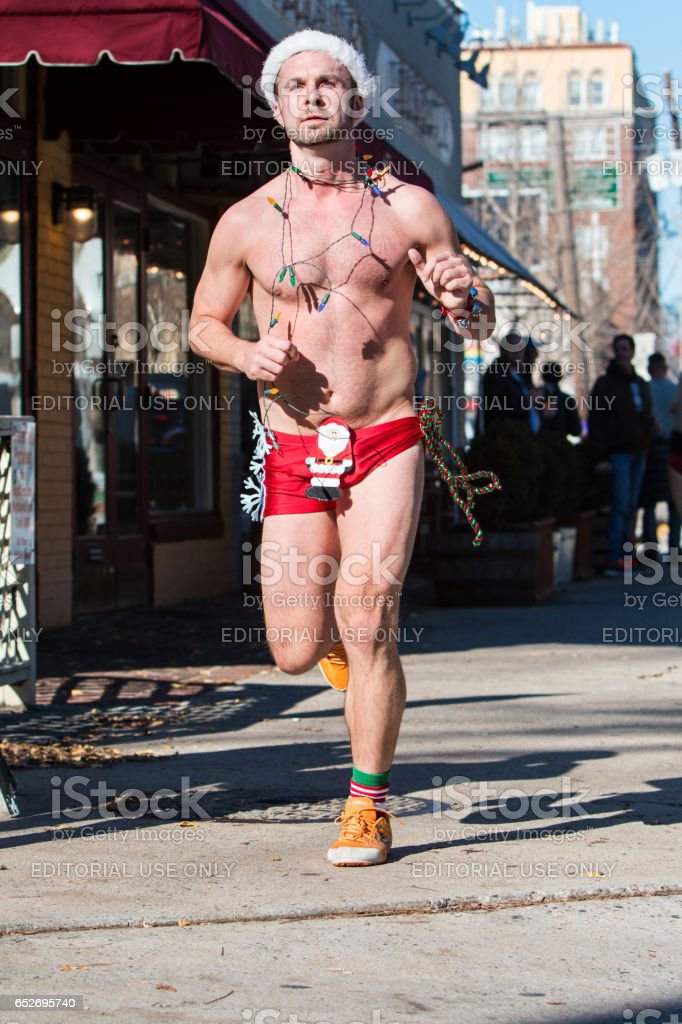 Male Runner Wearing Holiday Decorations Runs In Quirky Atlanta Event stock photo