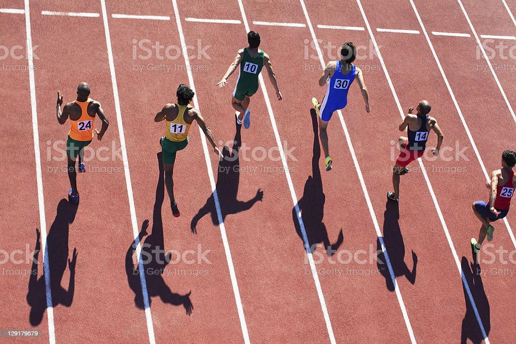 Male runners competing on track royalty-free stock photo