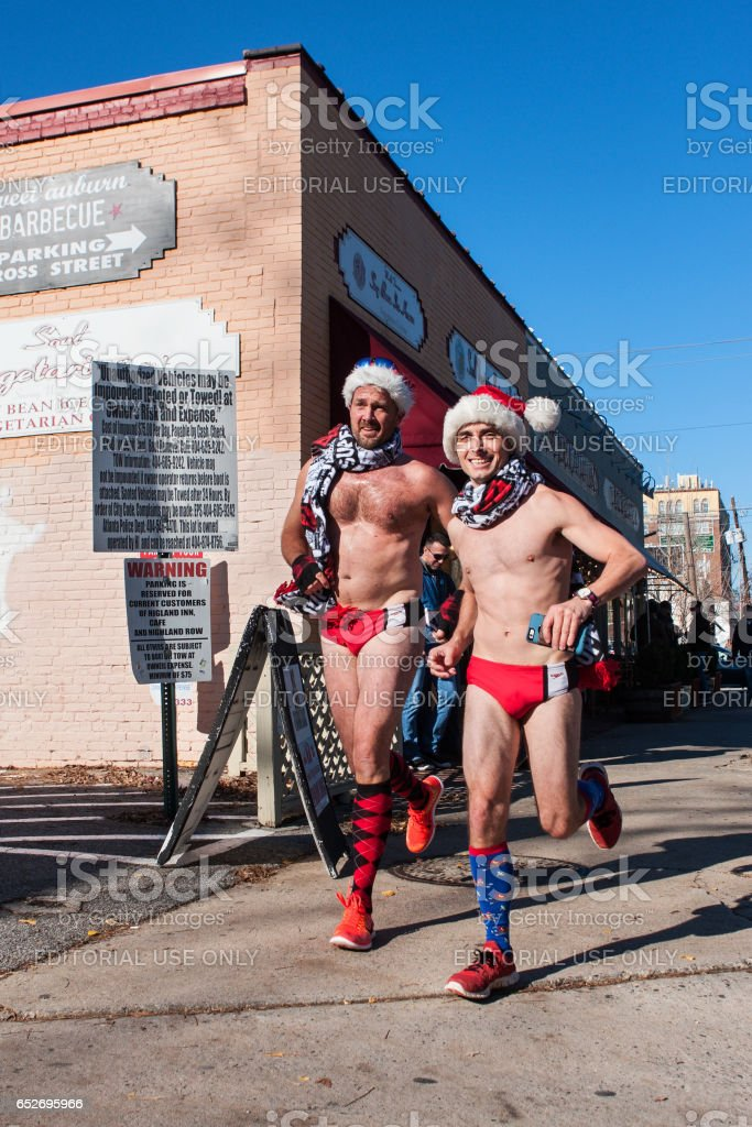 Male Runners Wearing Speedo Swimsuits Run In Quirky Atlanta Event stock photo