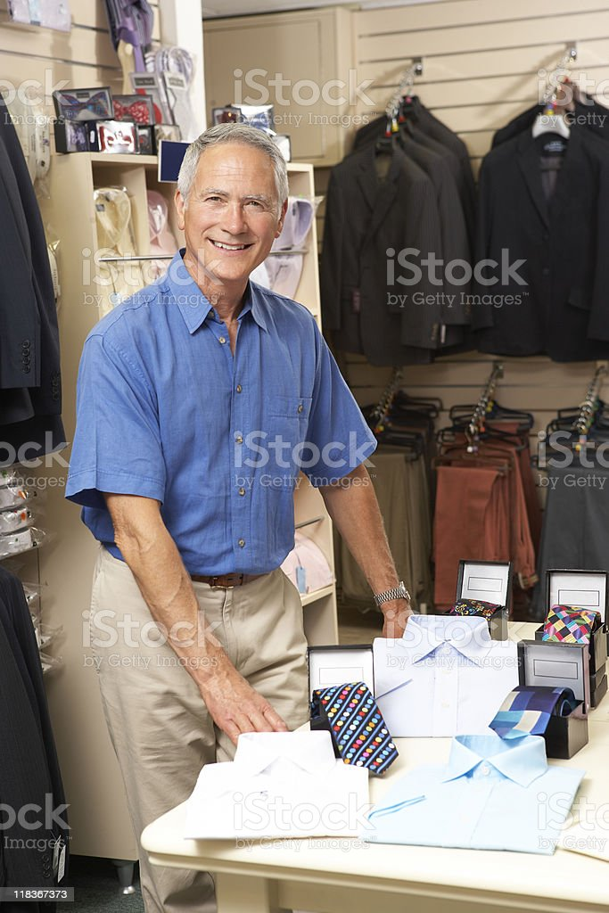 Male sales assistant in clothing store royalty-free stock photo
