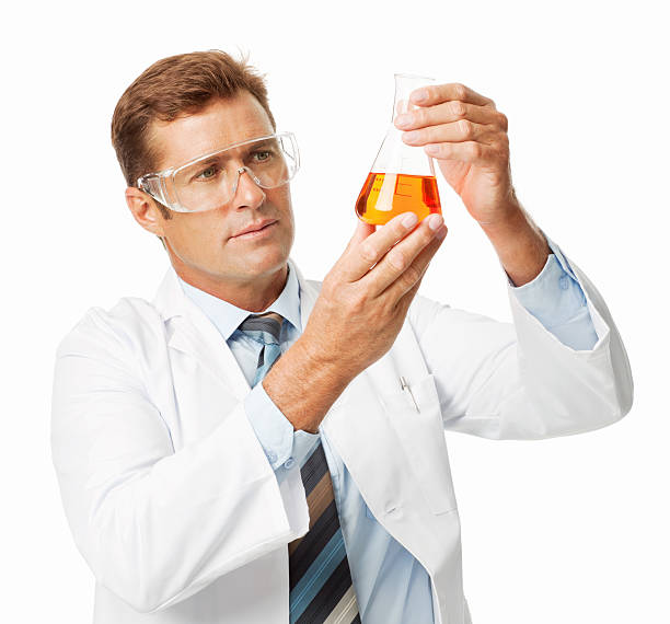 Male Scientist Analyzing Chemical Solution - Isolated stock photo