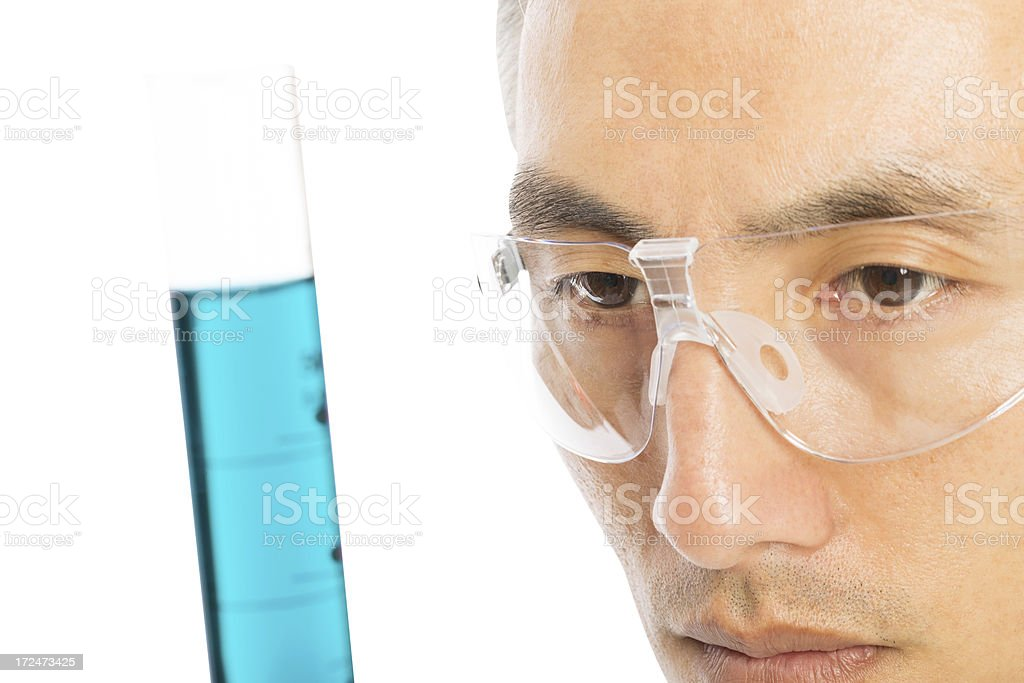 Male Scientist Looking At Chemical In Test Tube royalty-free stock photo