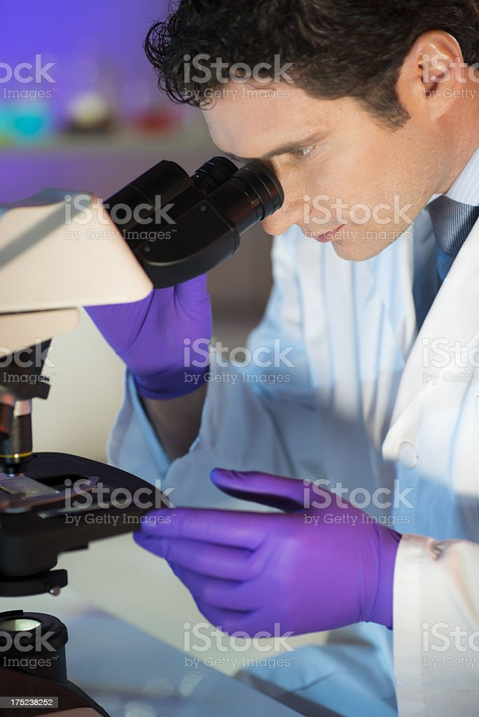 Male Scientist Looking Into Microscope royalty-free stock photo