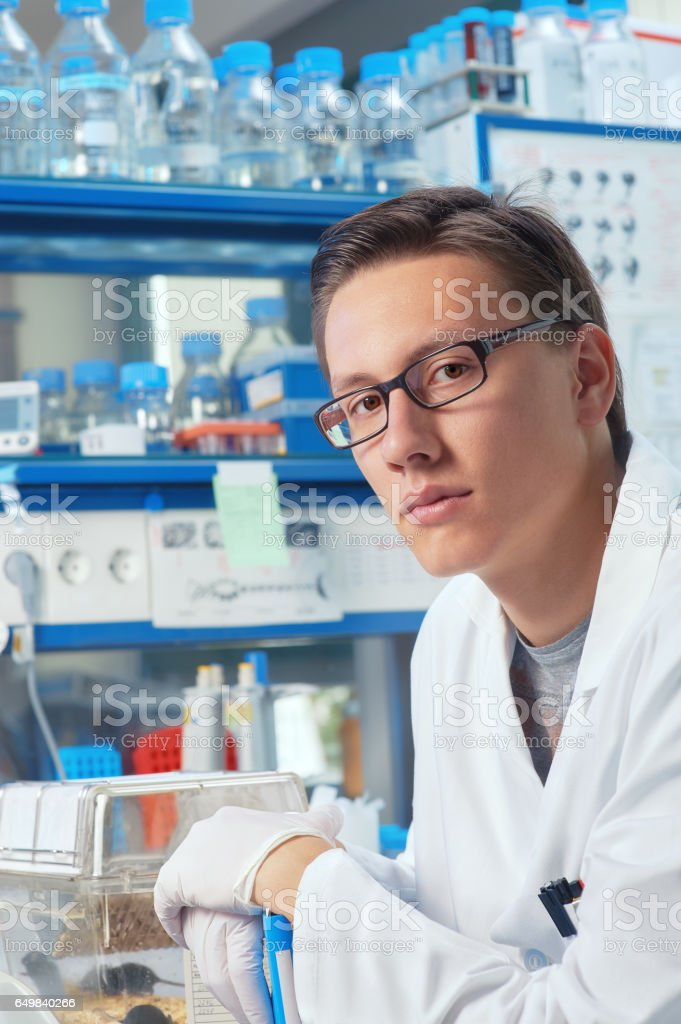 Male scientist or graduate student works in laboratory stock photo