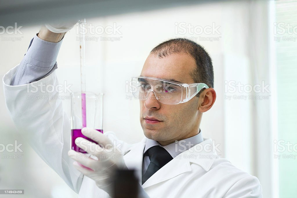 Male scientist working in a laboratory royalty-free stock photo