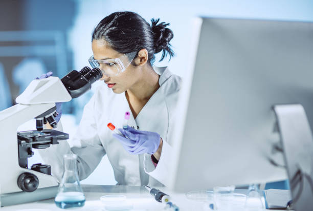 male scientist working in the laboratory - biology stock pictures, royalty-free photos & images