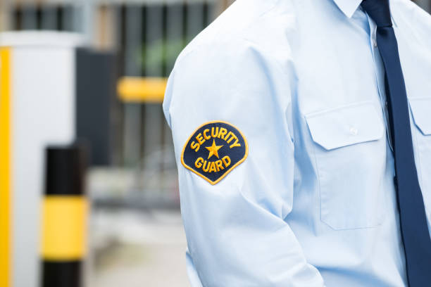 Male Security Guard In Uniform Close-up Of A Male Security Guard In Uniform security staff stock pictures, royalty-free photos & images
