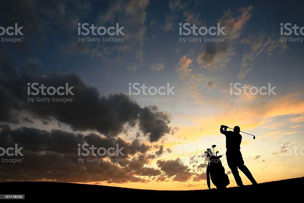 Male Senior Golfer Silhouette Back View stock photo