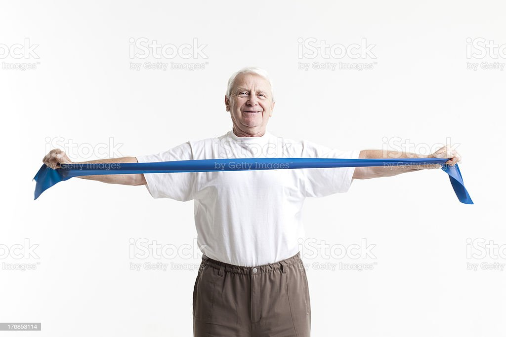 male senior stretching with a rubberband stock photo