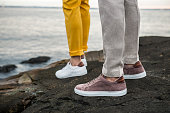Male shoes sneakers outdoors. Lifestyle photo of men`s casual shoes.