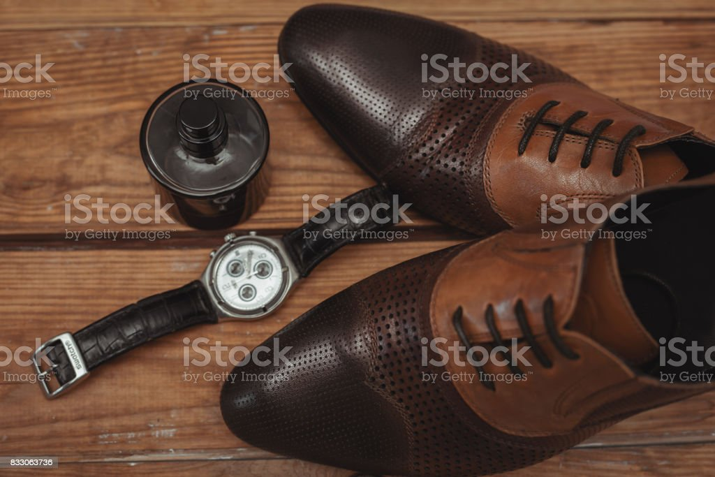 male shoes with watch and perfume stock photo