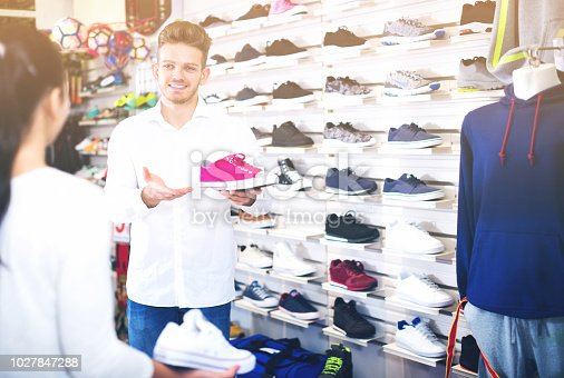 istock Male shop assistant helping customer 1027847288