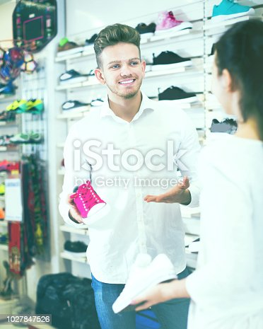 istock Male shop assistant helping customer 1027847526