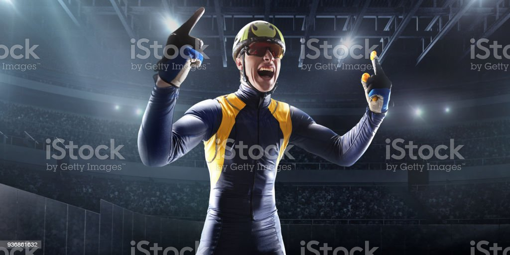 Male Short Track athlete rejoices in victory in professional ice arena stock photo