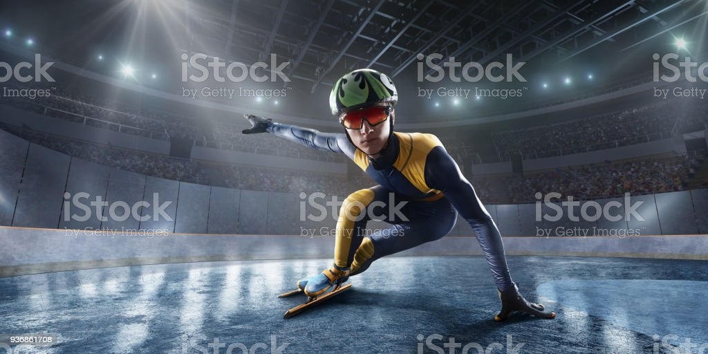 Male Short Track athlete slide in professional ice arena stock photo