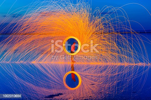 Male  silhouette in circle of sparks