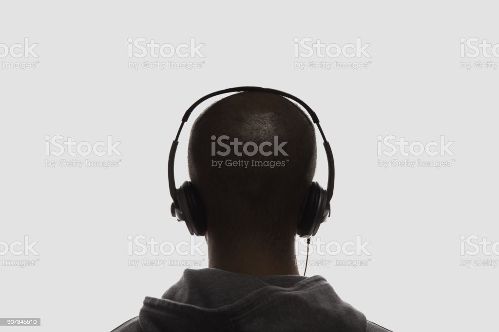 Male silhouette with headphones stock photo