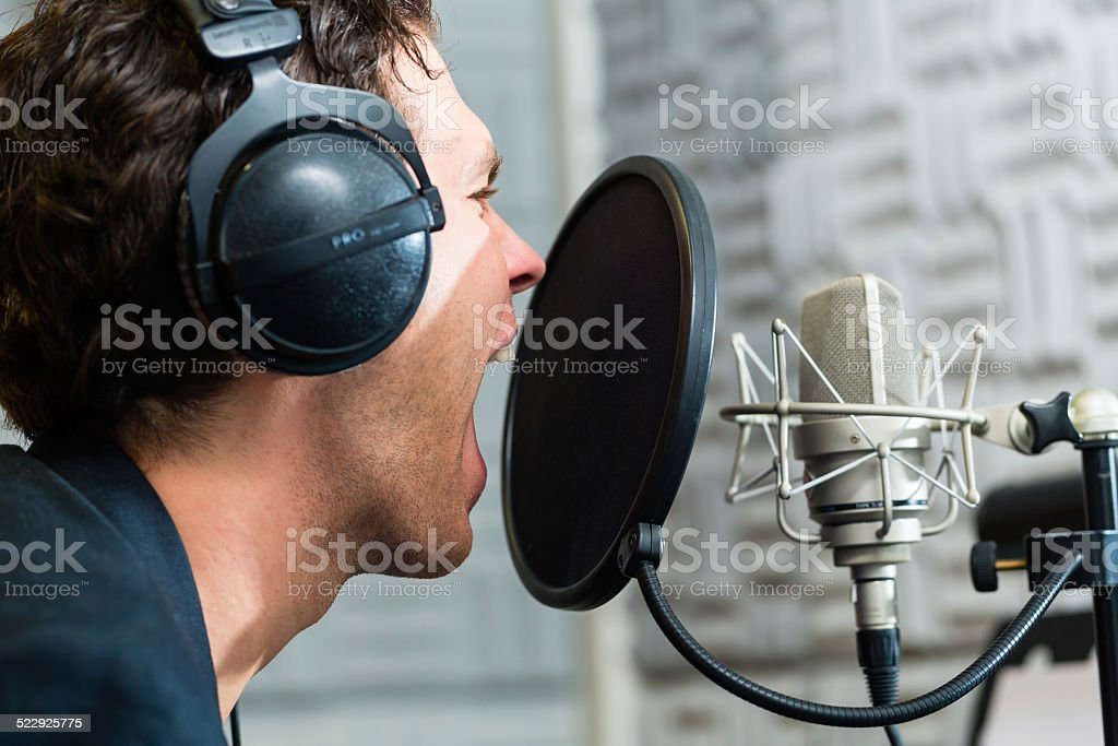 Male Singer or musician for recording in Studio stock photo