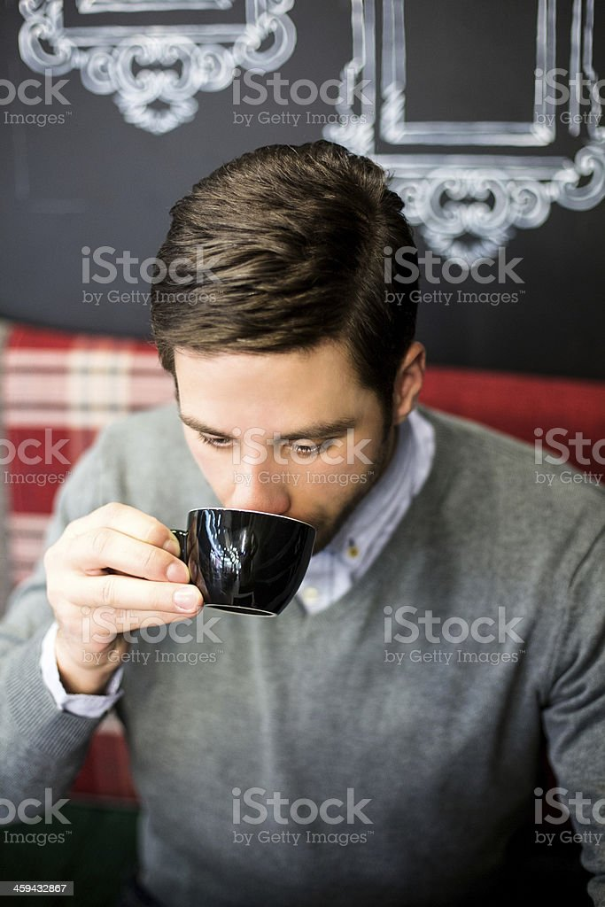 Male sitting in cafe royalty-free stock photo