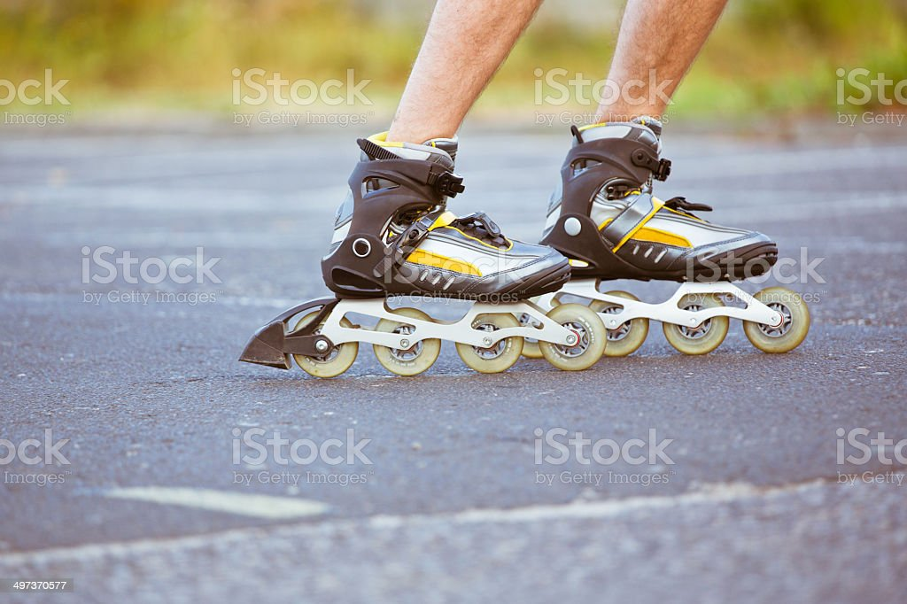 Male skater Close-up view of male legs in roller blades. Active Lifestyle Stock Photo