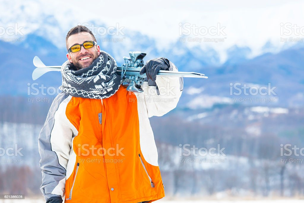 Male skier hiking in the snow mountain stock photo