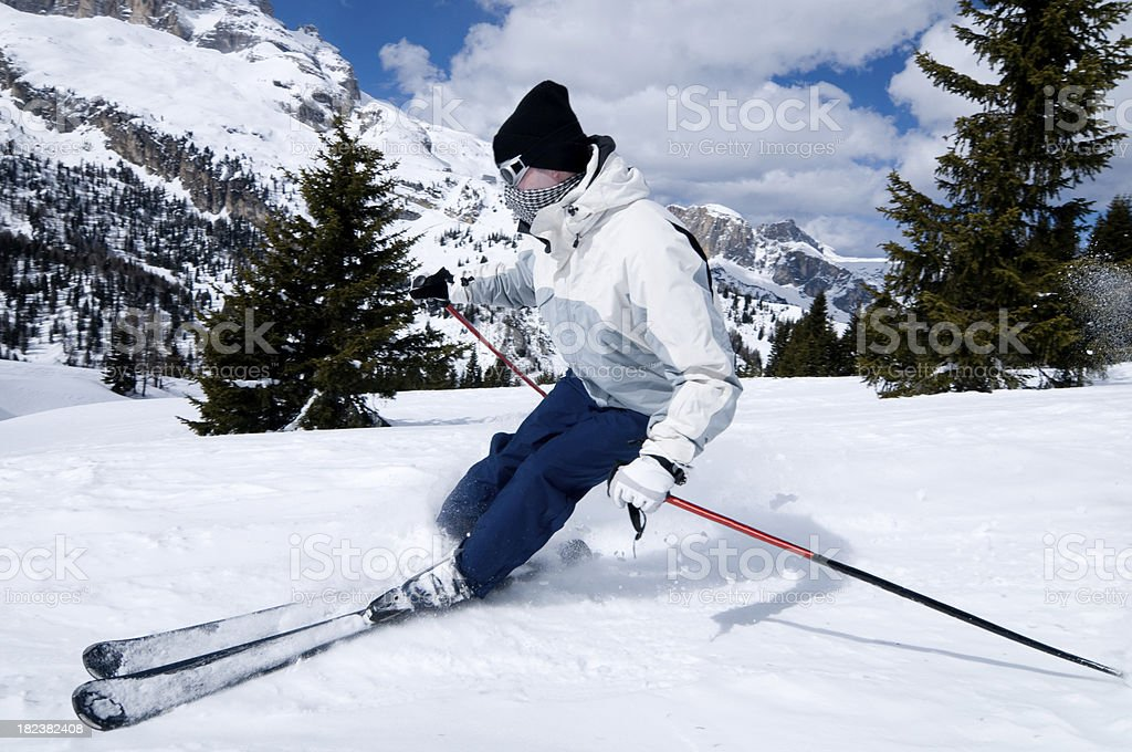 Male skier is skiing off piste between trees royalty-free stock photo