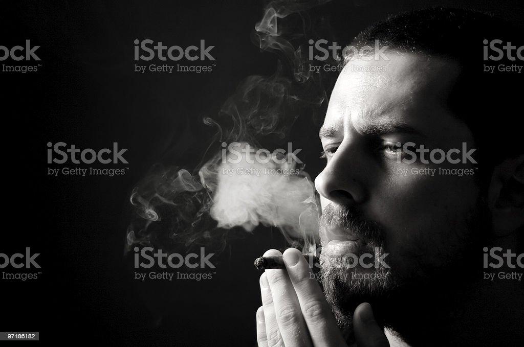 Male smoker in the dark royalty-free stock photo
