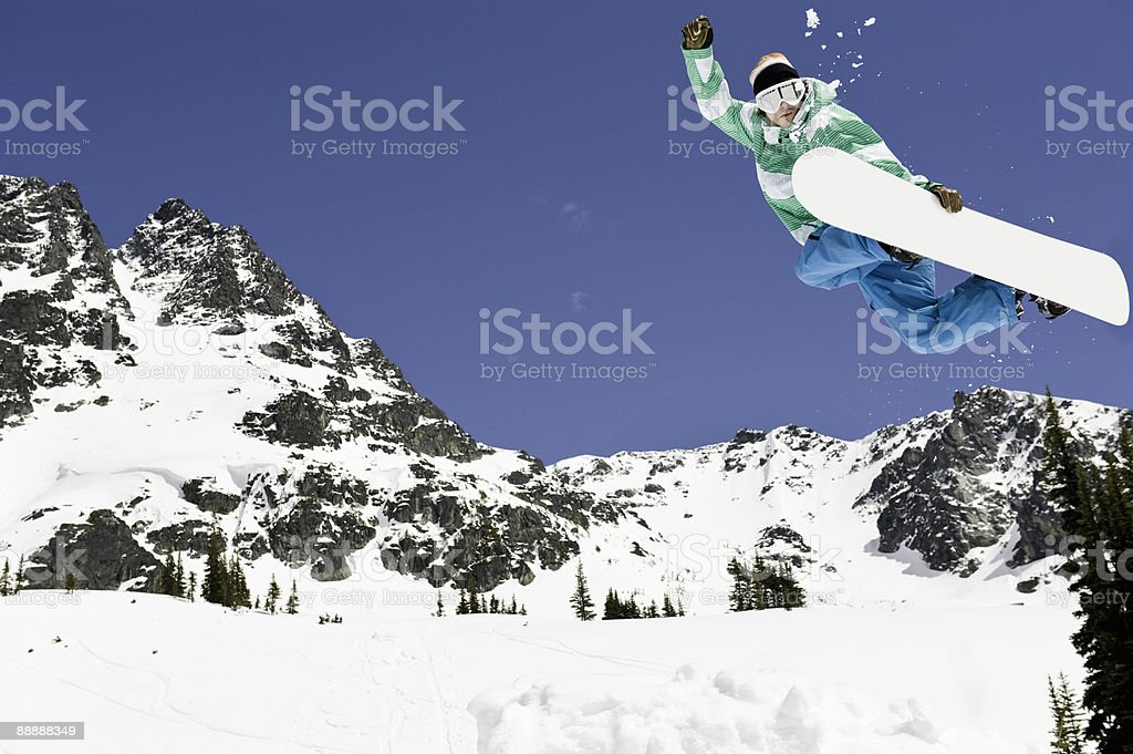 male snowboarder jumping in air royalty-free stock photo