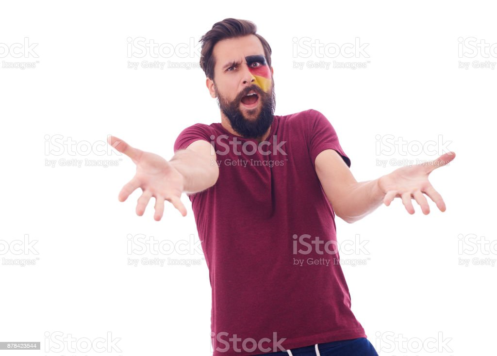 Male soccer fan watching soccer game in stress stock photo