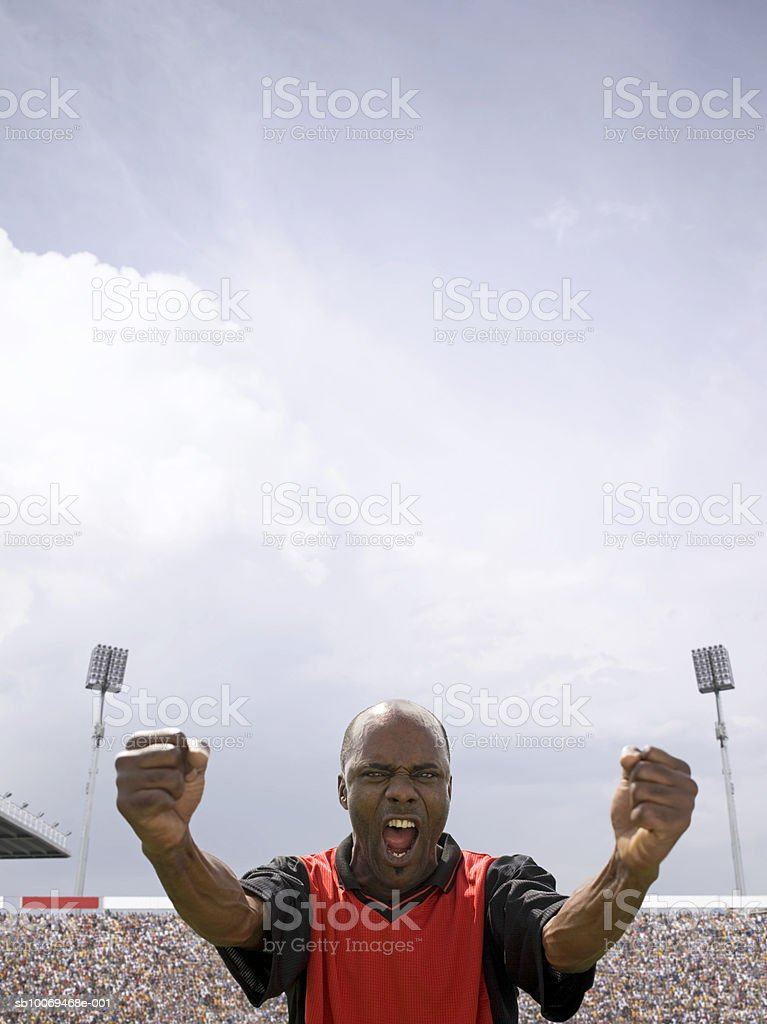 Male soccer player celebrating in stadium royalty-free stock photo