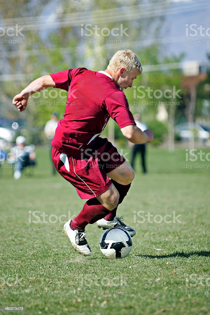 Male Soccer Player Makes for Ball of Twisted Muscle royalty-free stock photo