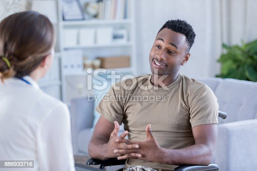 istock Male soldier discusses issues with therapist 886933716