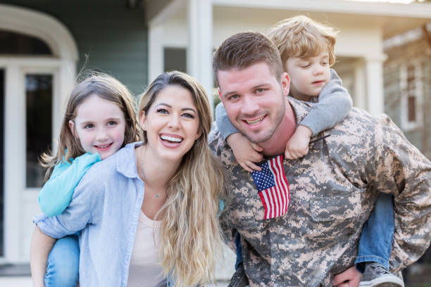 Male soldier is reunited with his family stock photo