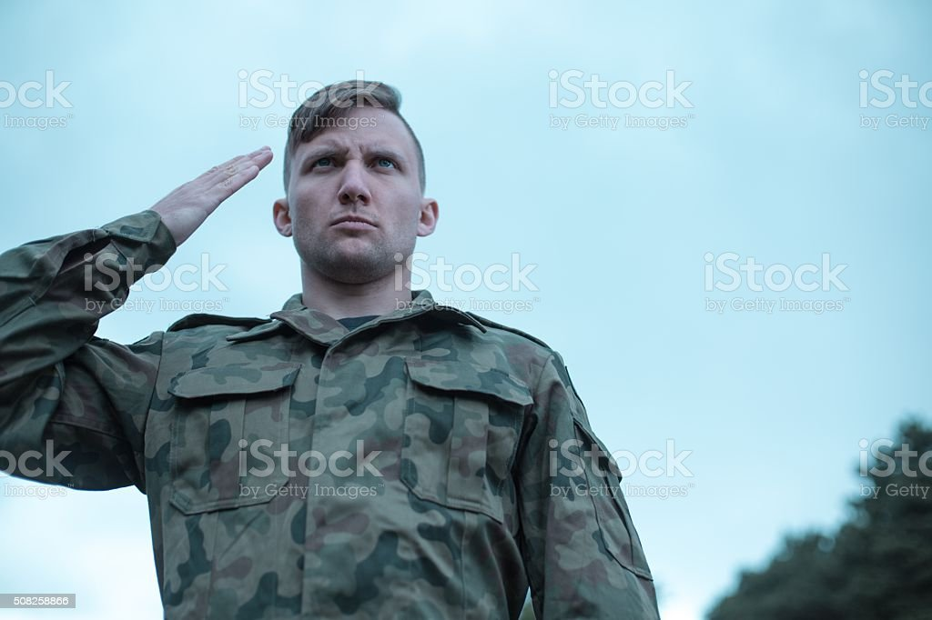 Male soldier saluting stock photo