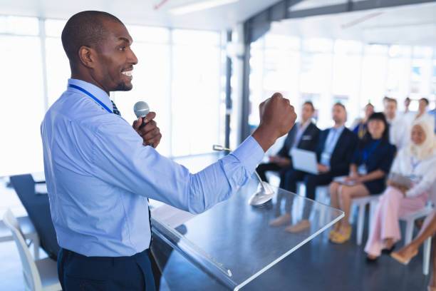Male speaker speaks in business seminar stock photo