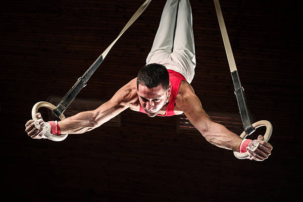 Male sportsman on gymnastics rings. stock photo