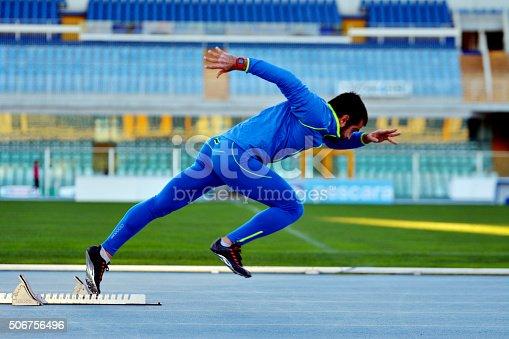 istock male sprinter leaving starting blocks 506756496