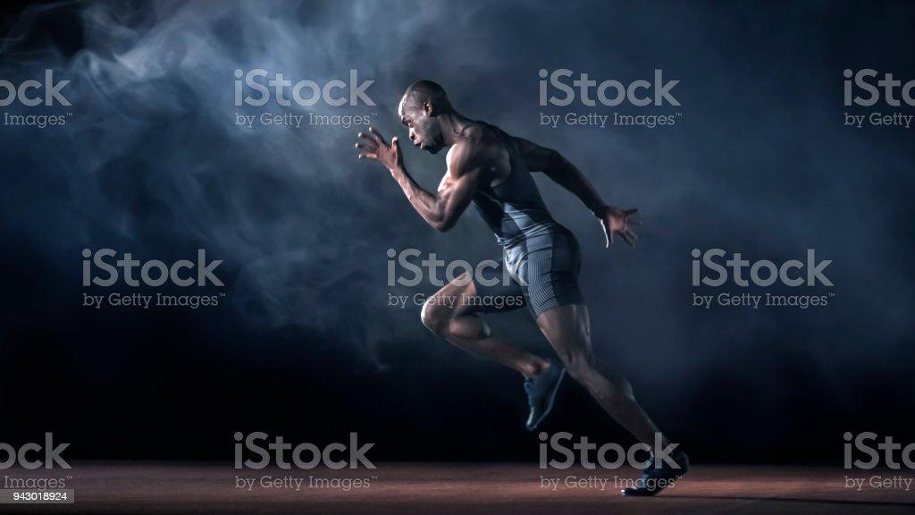 Male sprinter running stock photo