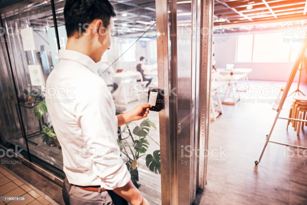 Male staff scan the Security card  to enter the operating room Male staff scan the Security card  to enter the operating room Accessibility Stock Photo