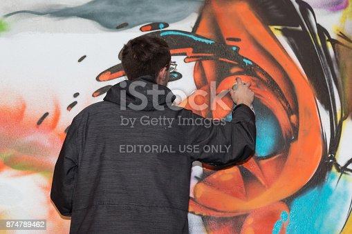 506166130 istock photo Male Street Artist: Spraying on Public Urban City Wall 874789462