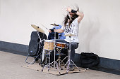 Male street musician playing drum set in subway - Moscow, Russia, November 12, 2020