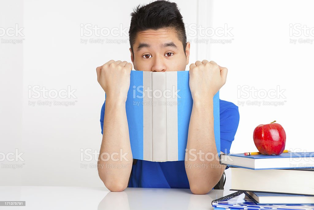 Male student holding book royalty-free stock photo