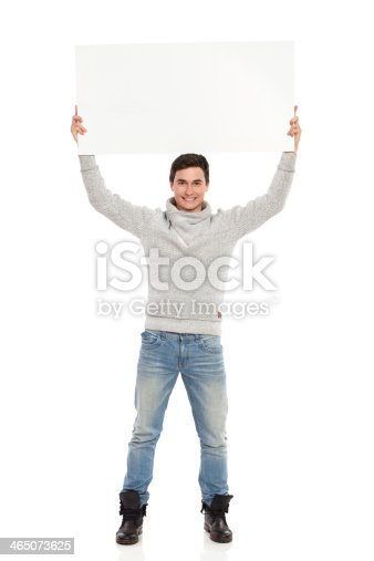 istock Male student showing banner. 465073625