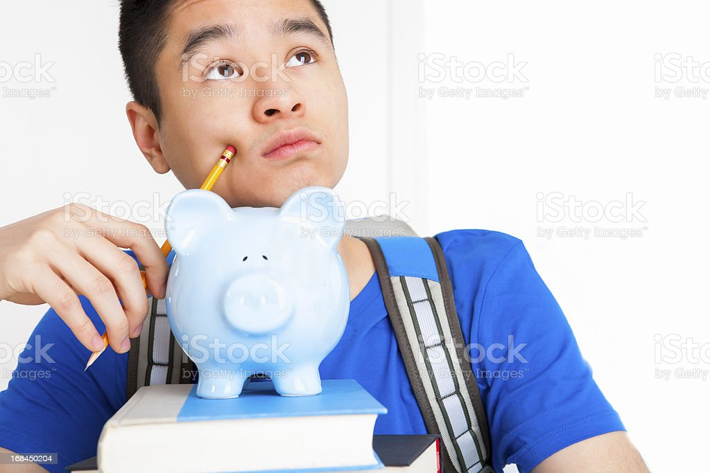 Male student thinking looking up royalty-free stock photo