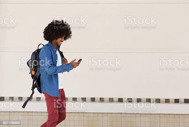 Male student walking with bag and mobile phone picture id507108558?b=1&k=6&m=507108558&s=612x612&h=a6hcz8wfmaxx4tdisvurbe2v8ffjjfuazknnl2lv31c=