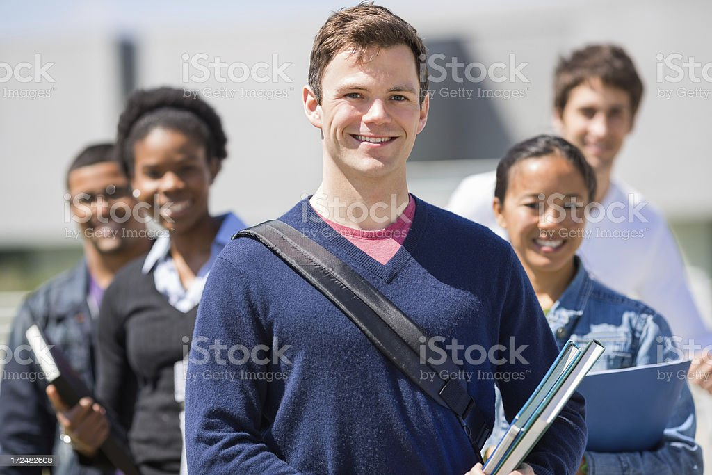 Male Student With Friends Standing In Background royalty-free stock photo