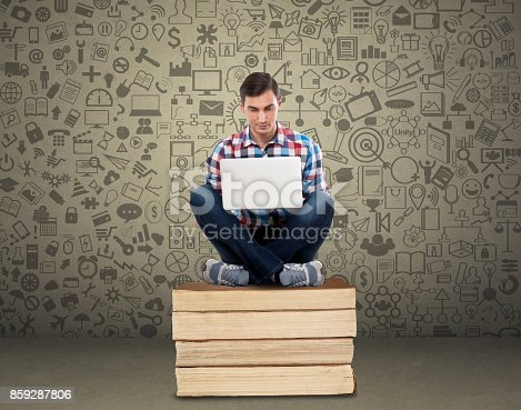 947303582 istock photo Male student working on laptop 859287806